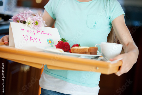 Mother's Day: Girl Carrying Tray with Breakfast For Mom