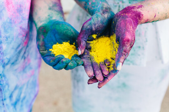 hands holding paint powder for Holi