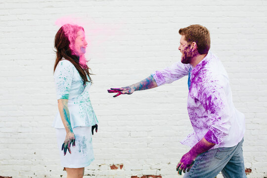 throwing Holi color in her face