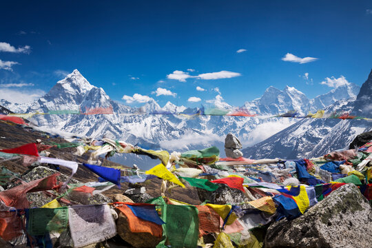 Himalayan mountain range viewed through flying tibetan prayer flags