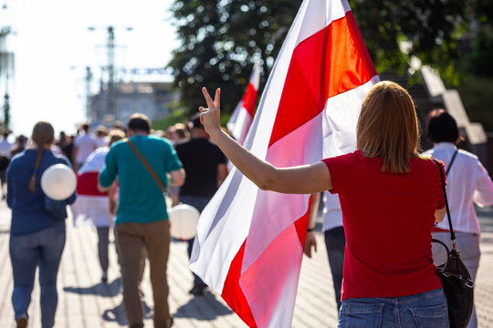 Minsk, Belarus - August 30, 2020. Peaceful protest actions against the current government after the presidential election in Belarus. Girl holding a flag.