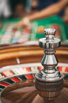 Casino: Roulette Wheel Waits As People Bet On Table