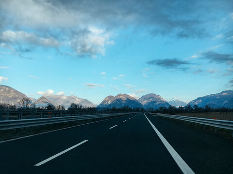 Empty highway with mountains on the horizon