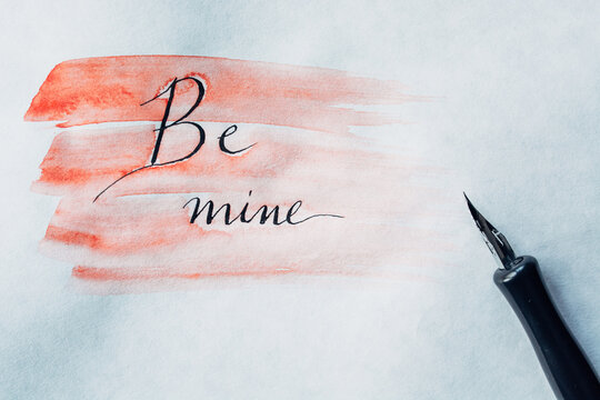 "Be Mine"""" written on a Valentine's Day card"