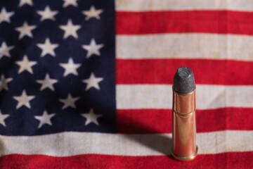 Single bullet on an old grungy US flag