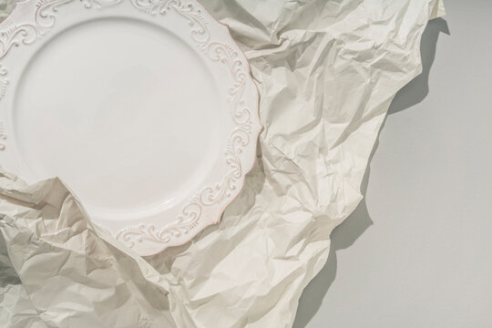 Plate Wrapped in Paper for Shipping