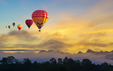 Door stickers Balloon Hot air balloon flying over misty morning and mountain in sunset Chiang Mai, Thailand