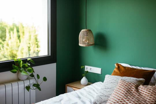 Lamp over cabinet in bedroom
