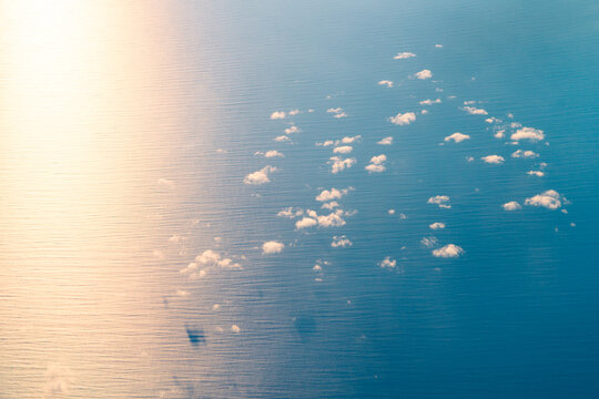 Sunset light over water, aerial view