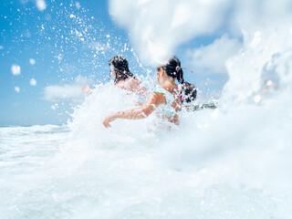 Kids splashing in the waves