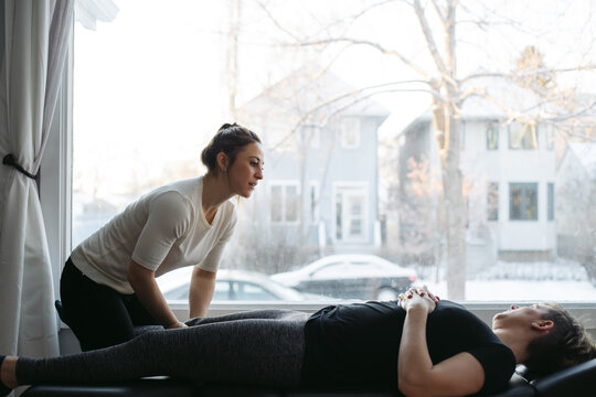 Young woman chiropractor giving treatment.