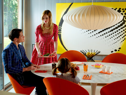 Contemporary family at the dining table in a mid-century modern home