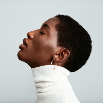 Black woman with plump lips in profile
