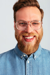 Lively adult man wearing stylish glasses in studio