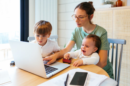 Remote worker mother with children at home