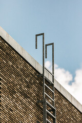 The ladder leading to the roof of a building