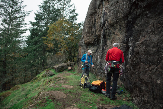 Two older friends enjoying nature and rock climbing together.