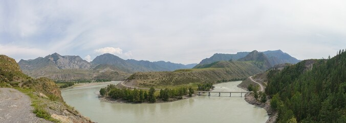 panoramic photo with a view of the Altai Mountains and the bridge over the Katun River to the village of Inegen