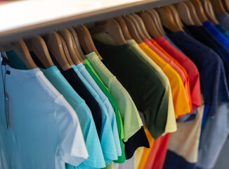 Close up of male shirts on hangers in clothing store