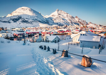 Great Christmas day on Lofoten Islands. Bright snowy cityscape of Sorvagen town, Norway, Europe. Amazing morning seascape of Norwegian sea.  Life over polar circle. Traveling concept background..