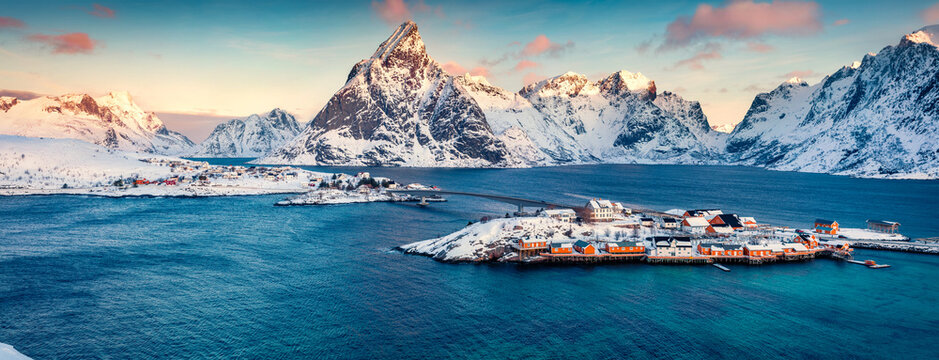 Aerial morning cityscape of Sakrisoy port. Panoramic view of Lofoten Islands with Kvalvik bridge. Amazing winter sunrise on Norwegian sea. Great outdoor scene of Norway. Life over polar circle.