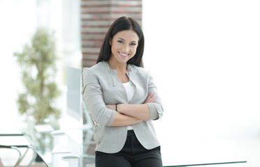 modern business woman on a blurred background.