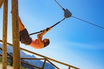 Adult woman having fun on zipline