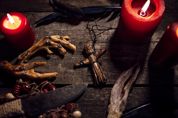 Dark Voodoo or vodun ritual with puppet, crow´s feet and knife