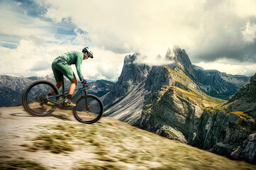 mountain biker in the mountains of the dolomites