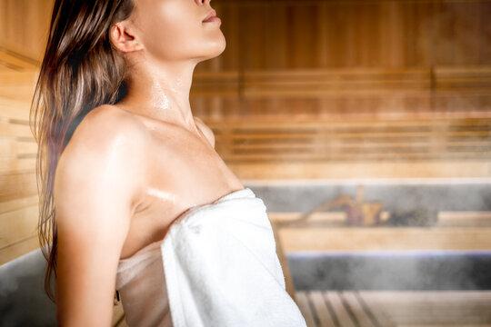 Relax in hot sauna woman skin detail