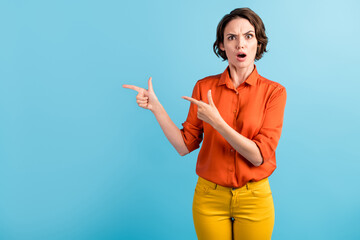 Photo of pretty shocked displeased lady direct fingers side empty space open mouth big prices...
