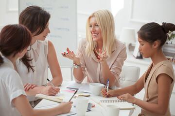 Smiling Businesswomen Working Together