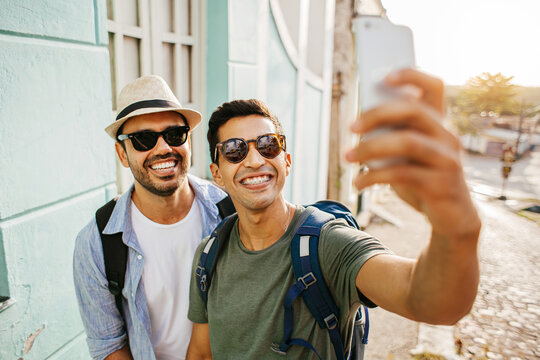 Two happy male tourists taking self portrait. Travel and love concept in Latin America