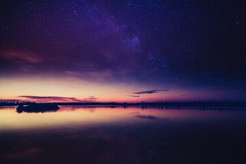 Lake at sunset, the first stars begin to appear