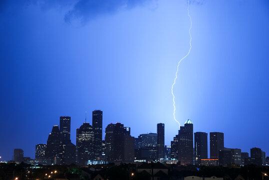 Lightning bolt hitting the Houston skyline
