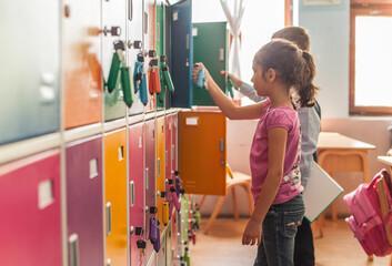 Schoolchildren Next to Their Lockers