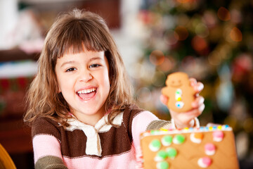 Gingerbread: Girl Laughs While Decorating House