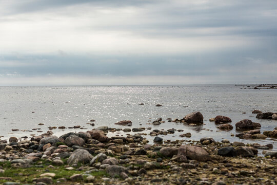 Rocky shore under gray clouds