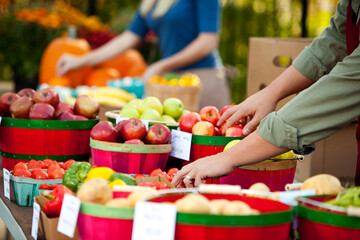Farmer's Market: Focus on Hands and Fruit