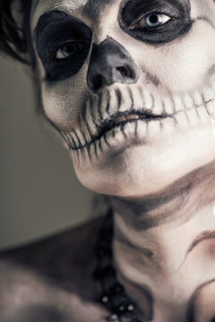 Woman Painted as a Frightening Skeleton
