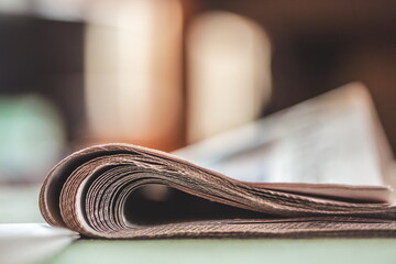 Folded newspapers on a table