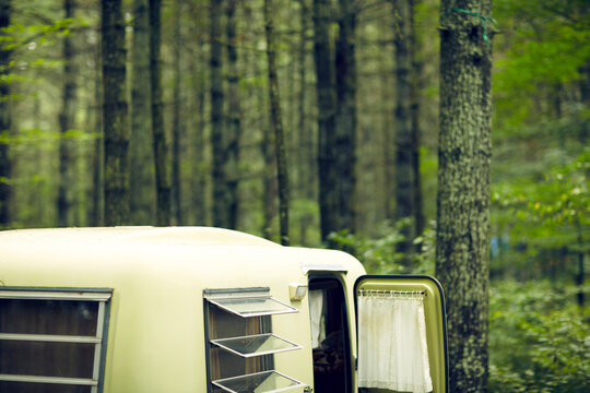 Vintage Trailer camping in forest