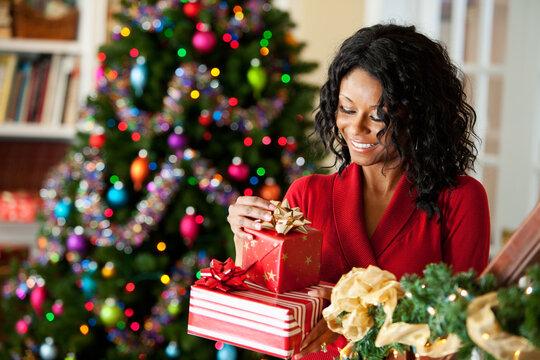 Christmas: Woman Reading Label on Christmas Gift