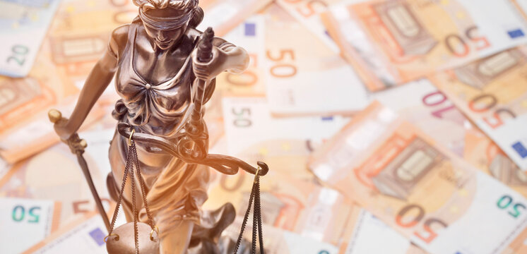 Lady Justice is on several 50 and 20 Euro bills. Concept photo for a lawsuit where a lot of money is at stake.