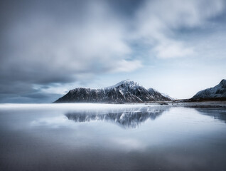 Skagsanden beach, Lofoten islands, Norway. Mountains, beach and clouds. Long exposure shot. Night time. Winter landscape near the ocean. Norway - travel