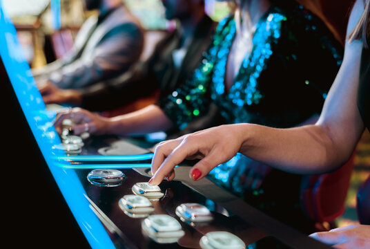 girls playing casino slot machines with colored lights