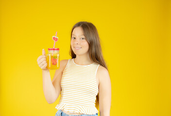 Smiling beautiful girl with long hair with a juice