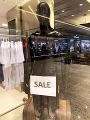São Paulo, SP, Brazil. August 31, 2020. Empty mannequin in a store affected by the quarantine, with the word sale.