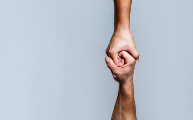 Helping hand concept and international day of peace, support. Two hands, helping arm of a friend, teamwork