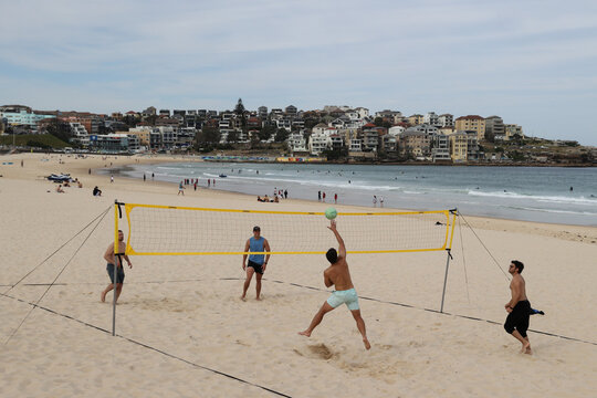 People play volleyball at Bondi Beach in Sydney